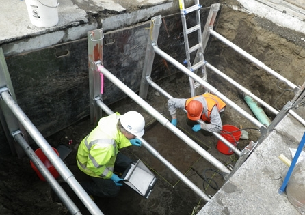 Archaeological wet-screening operation at the South Park Bridge site. HRA conducted archaeological and architectural historical reviews, effects analysis, and mitigation actions for this bridge replacement project.